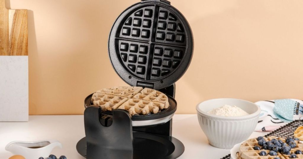 open waffle maker with a waffle in it