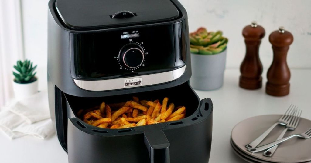air fryer with french fries in it
