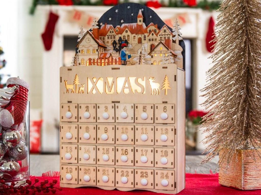 Wooden Christmas Village Advent Calendar Decoration w/ LED Light Background
