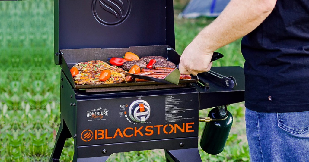 person grilling on a blackstone griddle