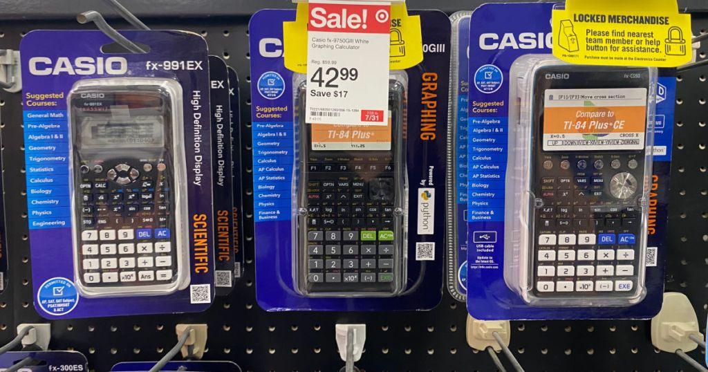three calculators on rack