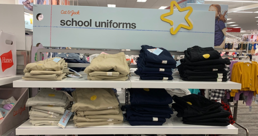 khaki and black uniform bottoms on shelf