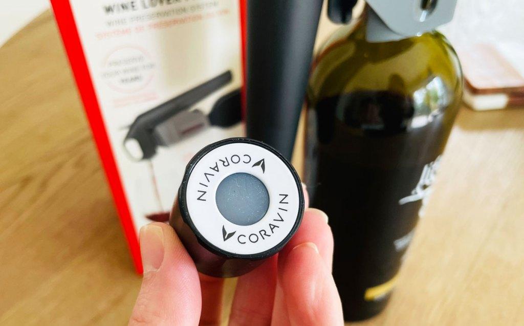 holding up wine screw top