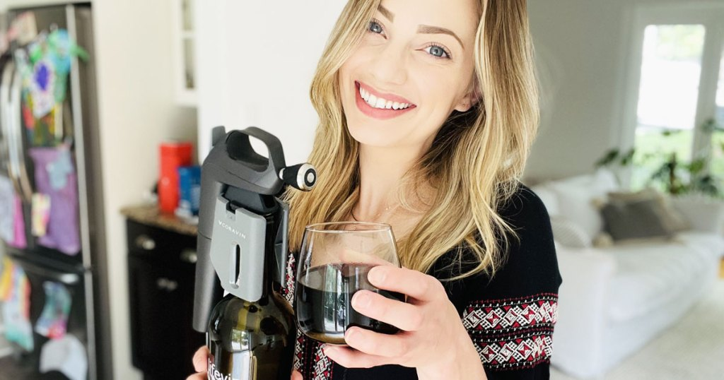 woman holding glass of wine and preservation system