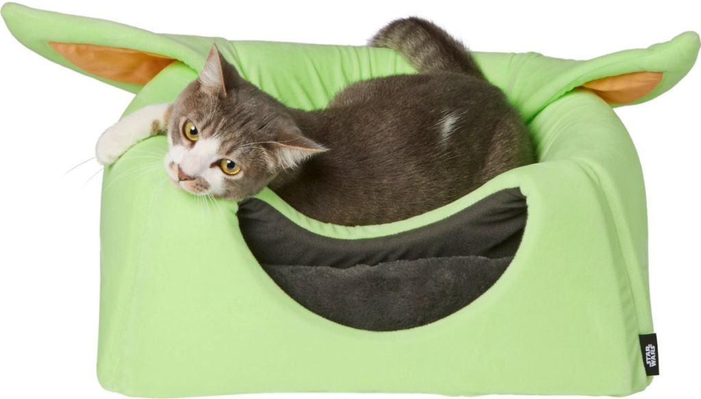 cart laying on to of The Child pet bed