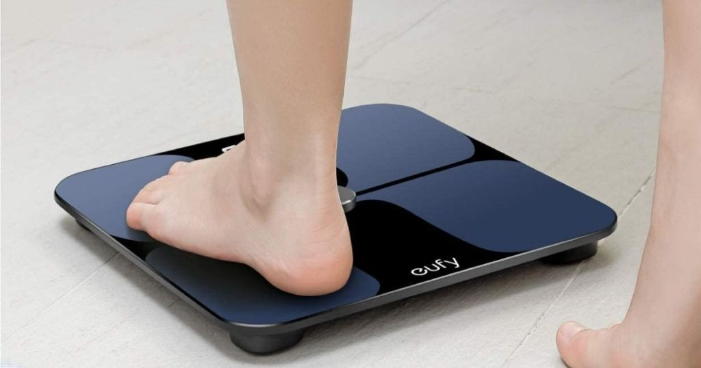 person stepping onto Eufy Smart Scale