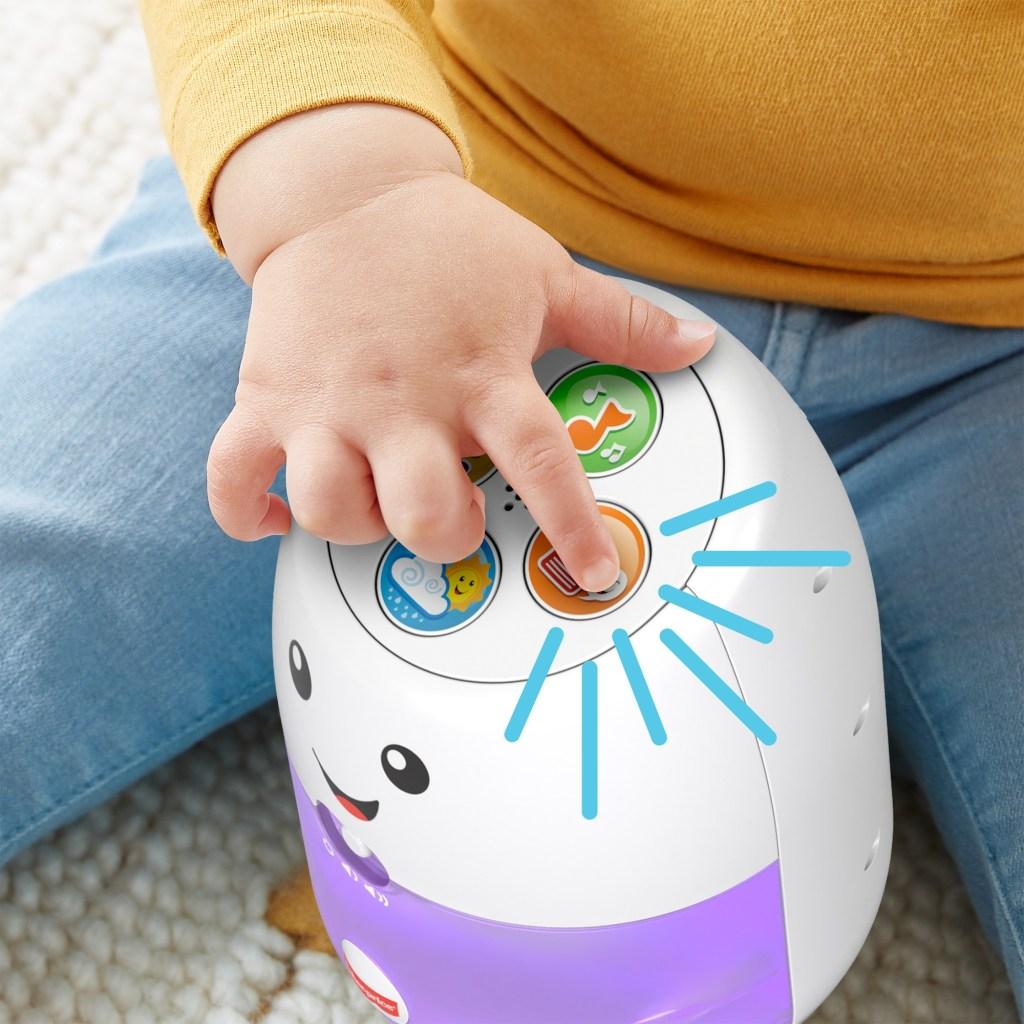 baby pressing Fisher Price Hub