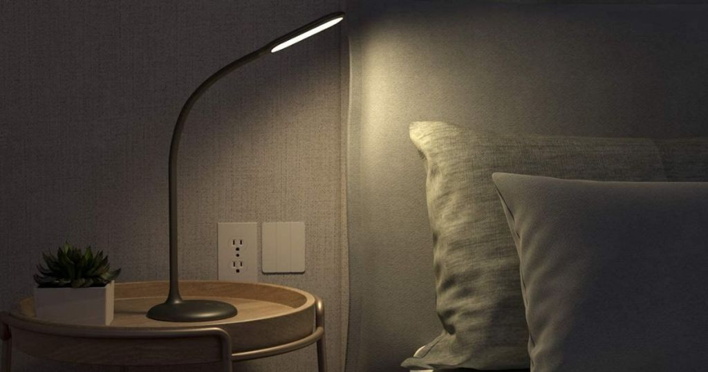 lamp next to a bed