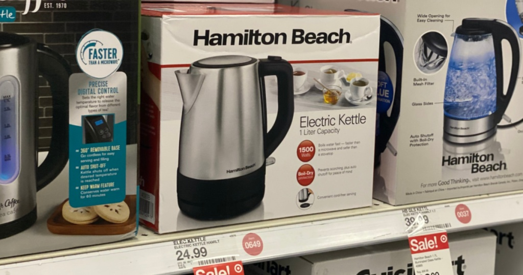 stainless steel electric kettle on shelf