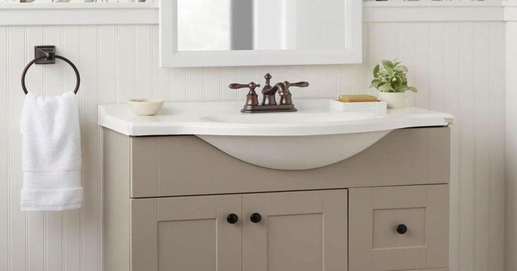 bathroom vanity with bronze faucet