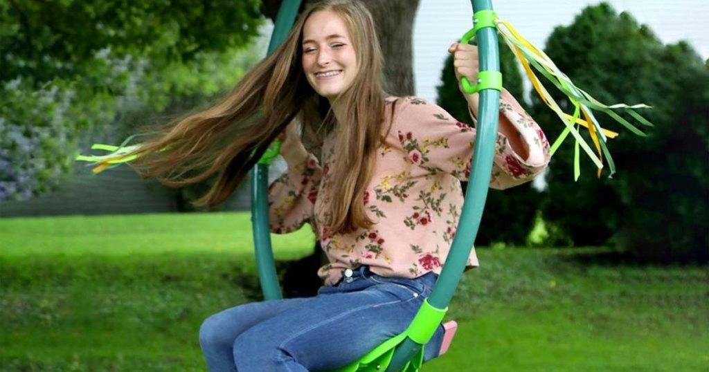 girl on green ring swing