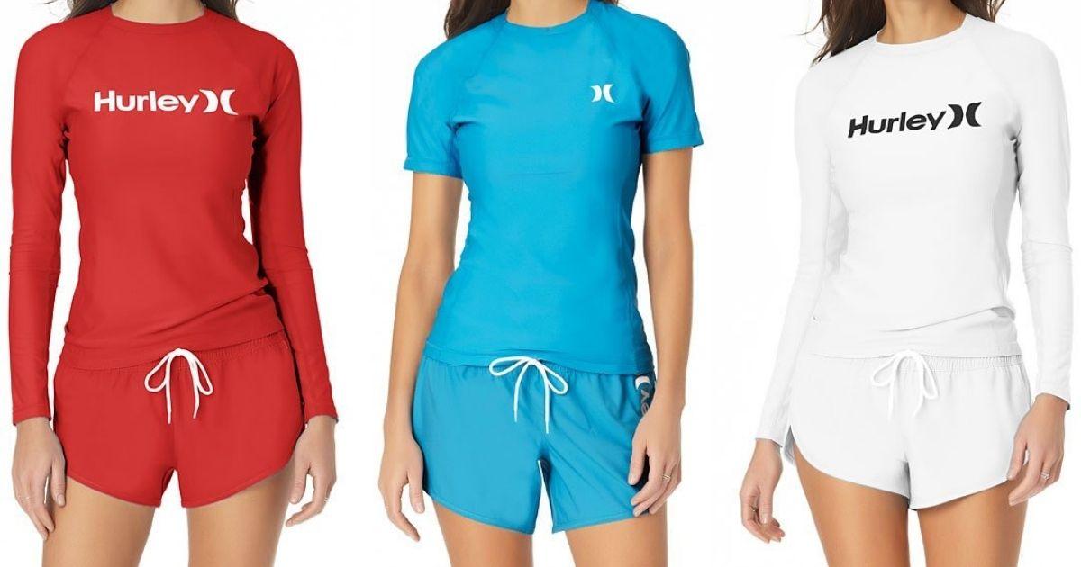 three women wearing rashguards and board shorts