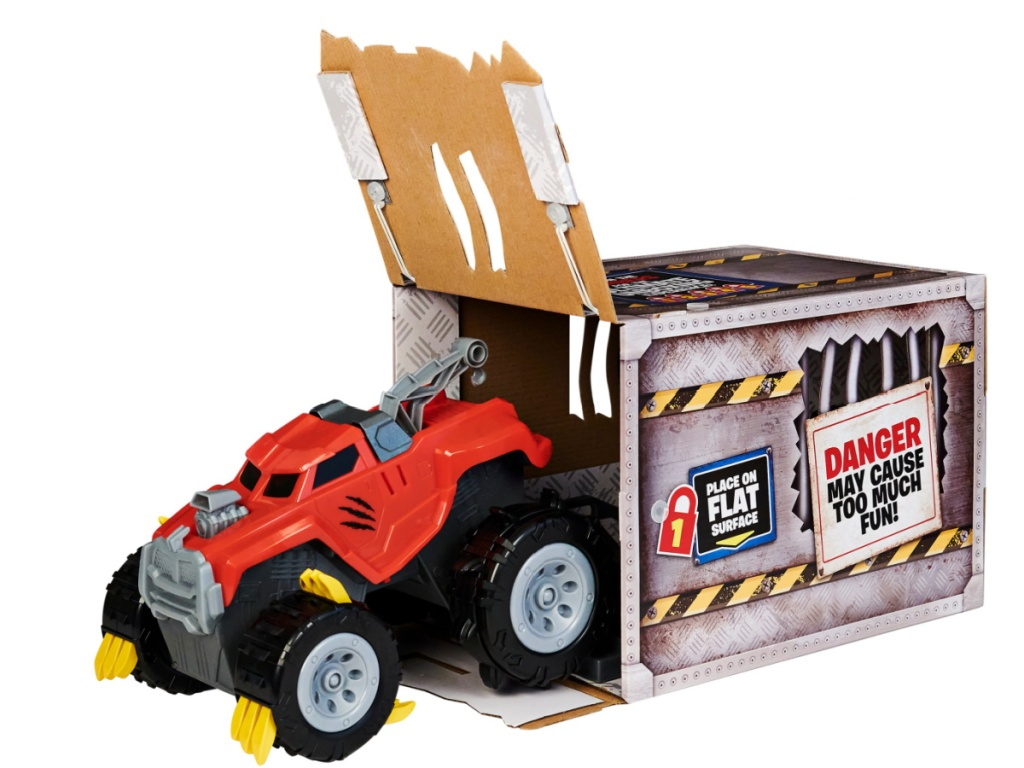 monster truck toy rolling out of packaging