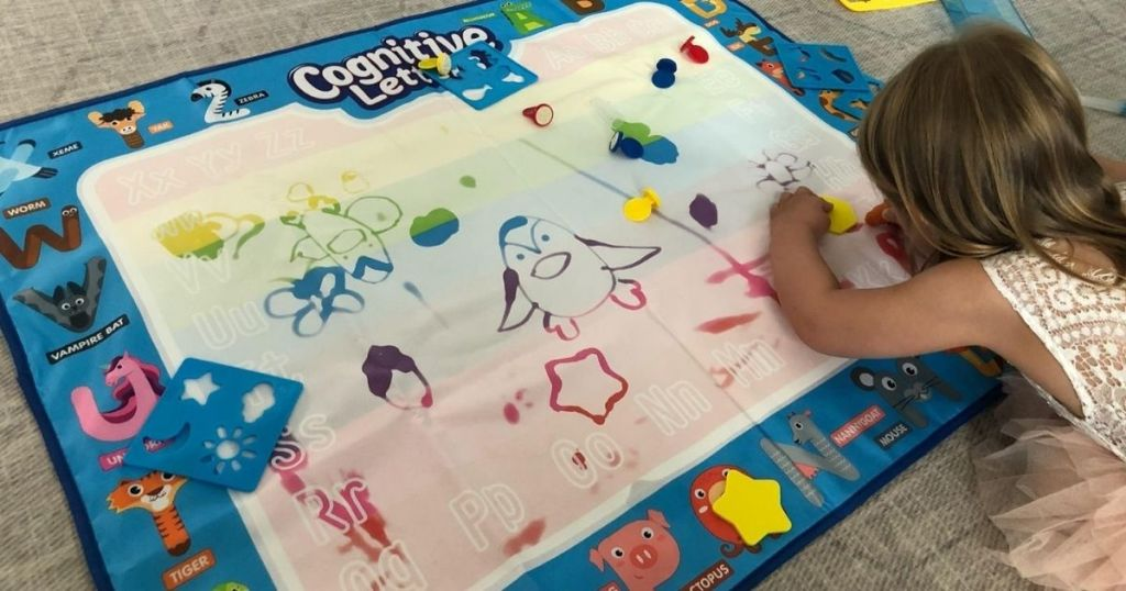 girl coloring on a mat