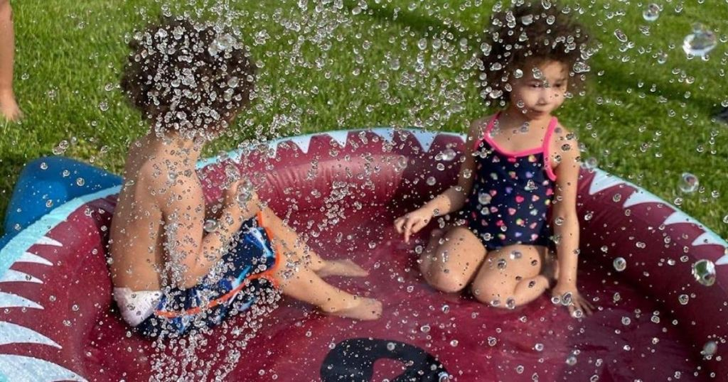 two kids in a pool