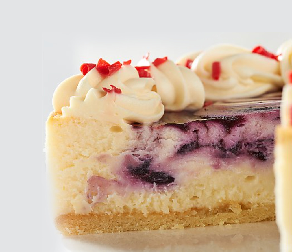 inside piece of a New York cheesecake with blueberry puree swirl
