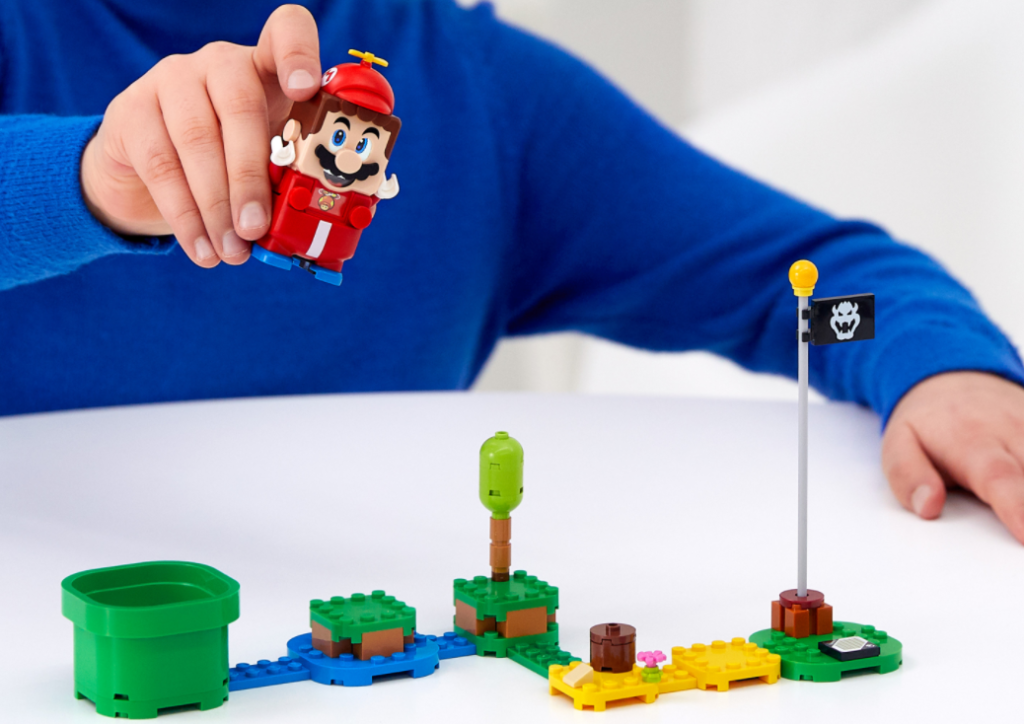 kid playing with Super Mario LEGO set