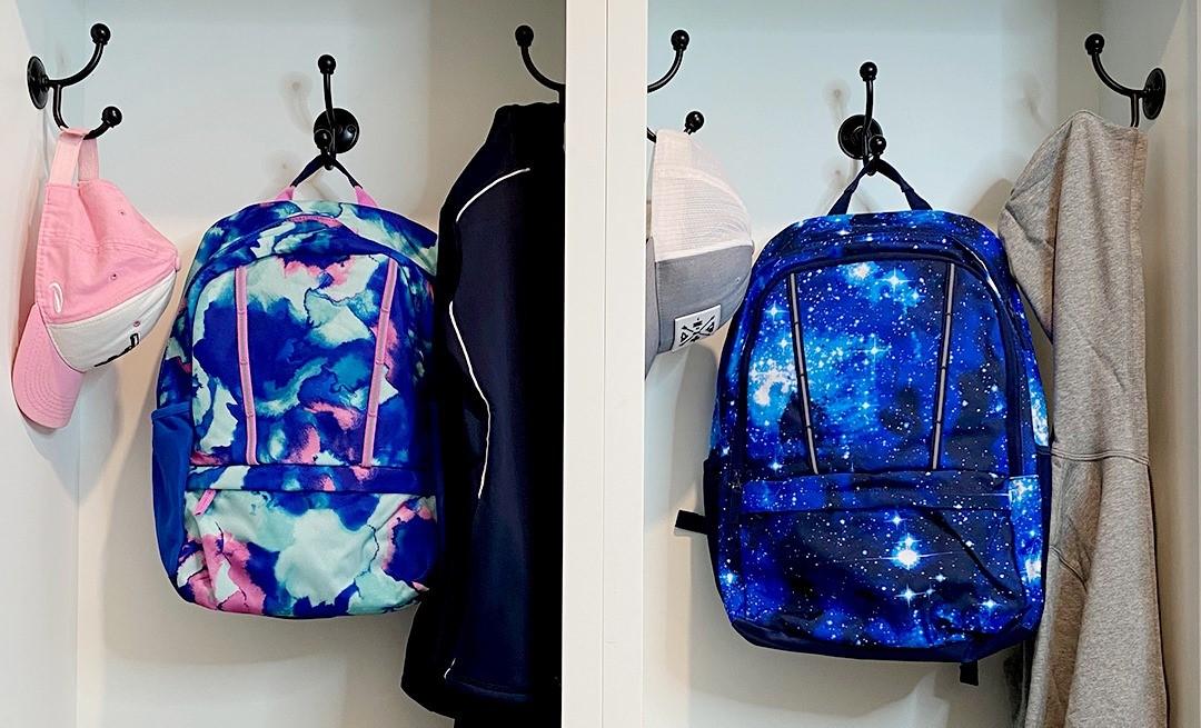 two backpacks on hooks