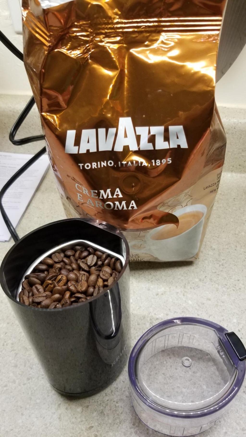 Lavazza Crema E Aroma Bag next to coffee grinder
