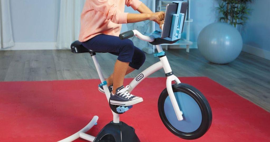 girl riding little tikes bike