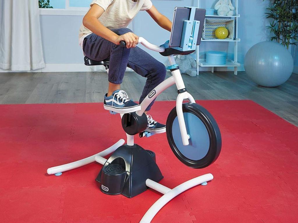 boy riding little tikes bike