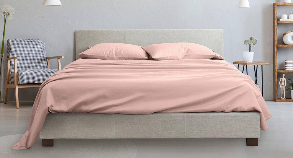 bed with pink sheets on it