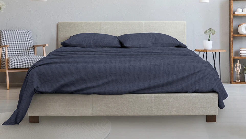 bed with blue sheets on it