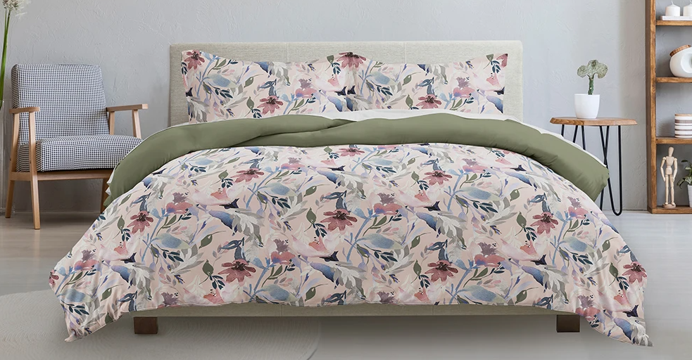 bed with a floral comforter on it