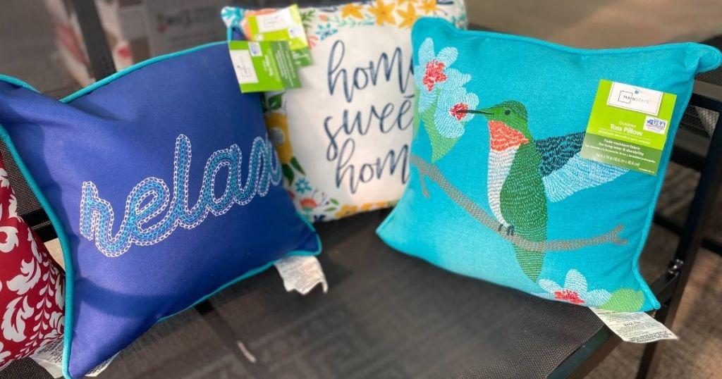 three outdoor pillows