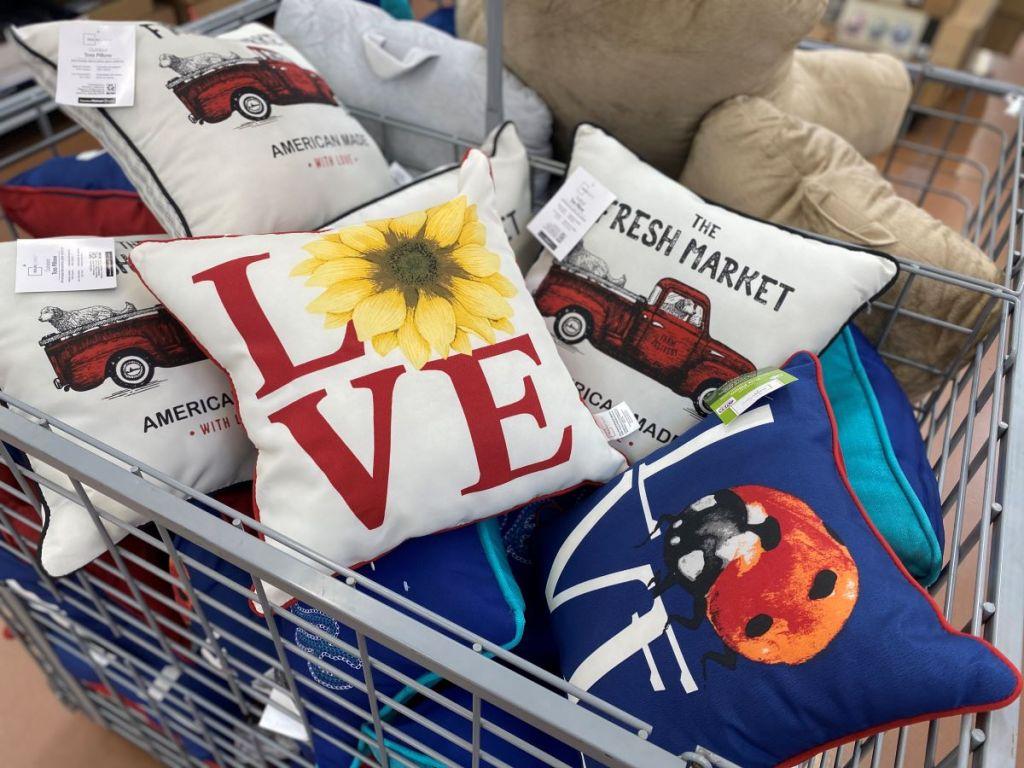 bin of outdoor pillows at Walmart
