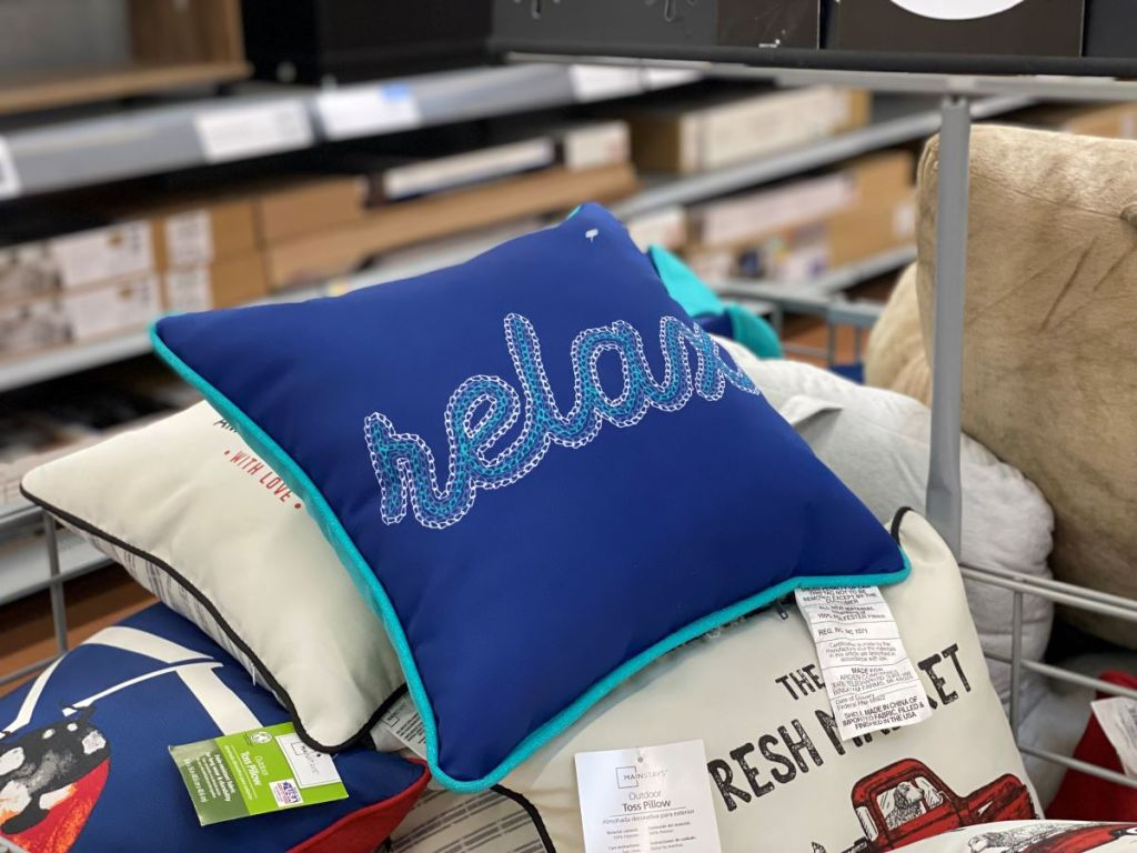 outdoor pillow that says relax