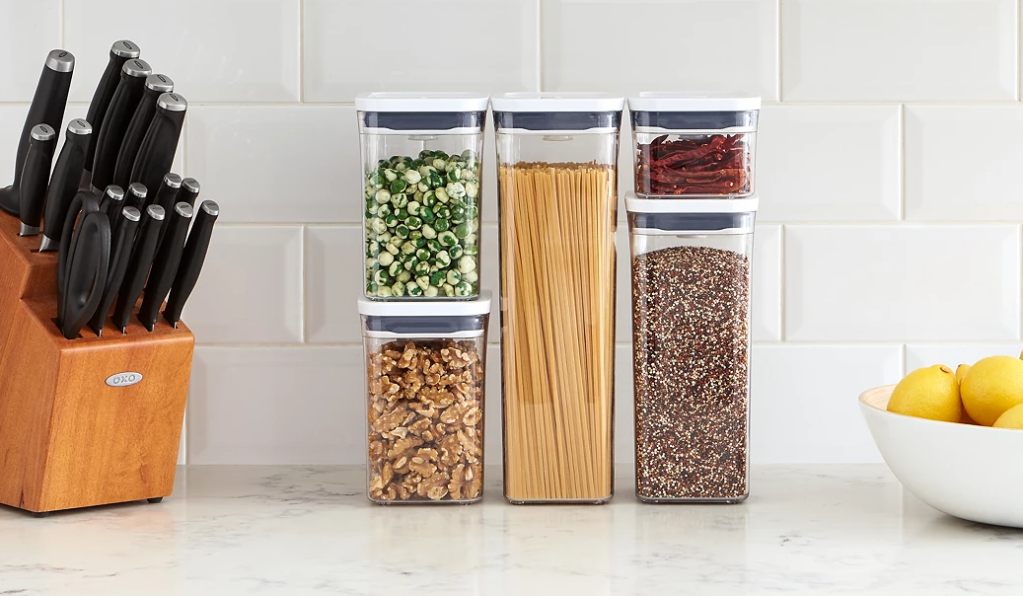 OXO container set on a counter by a knife set