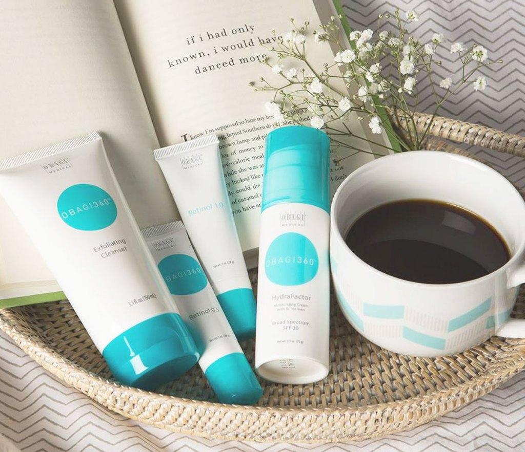 obagi skincare products near book and coffee mug