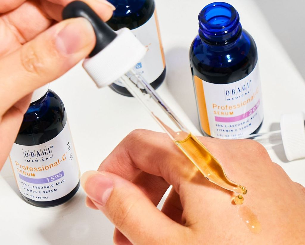 hand putting serum on another hand