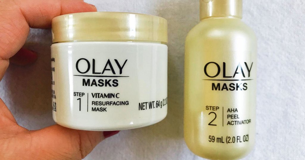 hand holding two step olay mask set