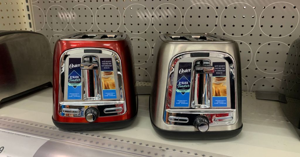 red and silver toaster on shelf