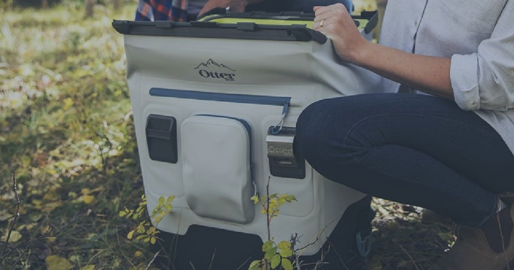 Gray OtterBox Cooler on forest floor