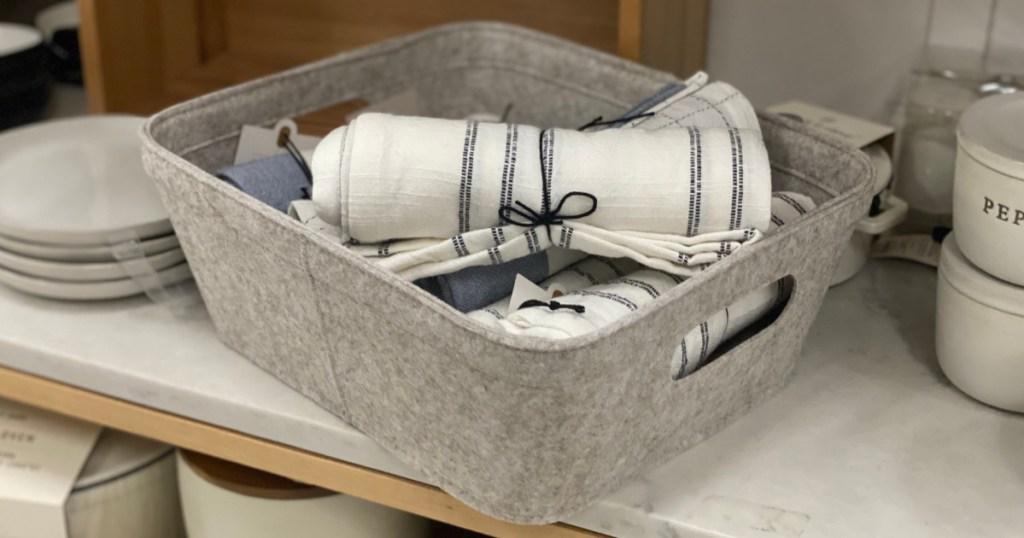 tan basket on shelf with napkin inside