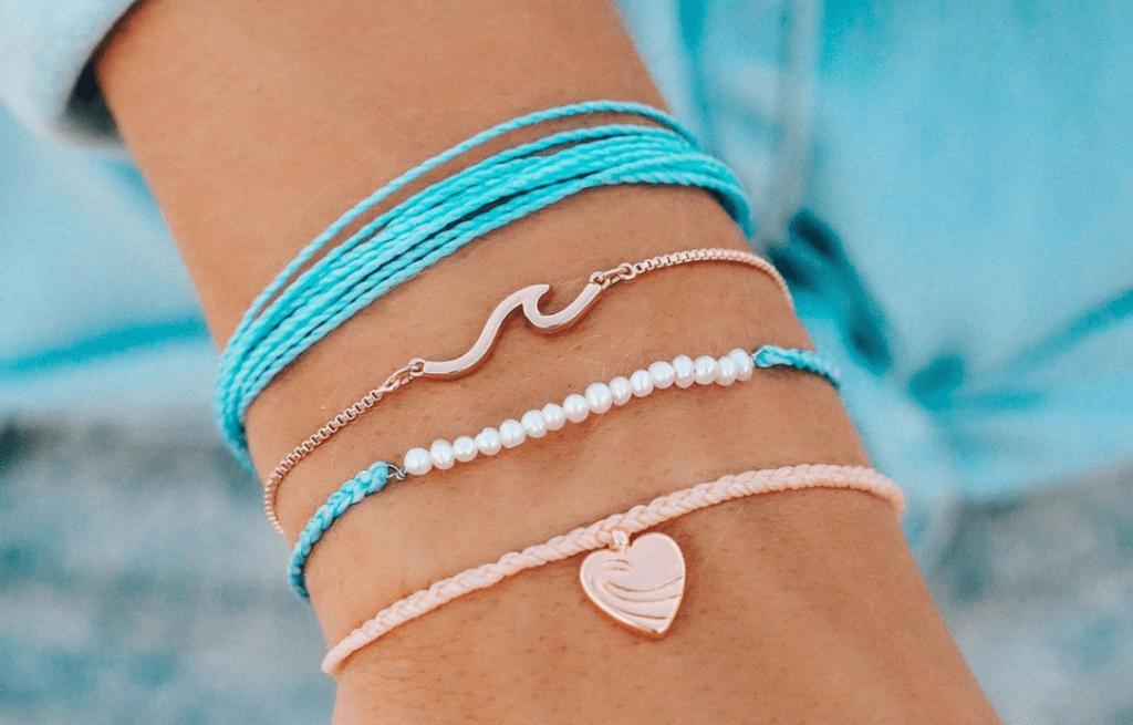 arm with four bracelets