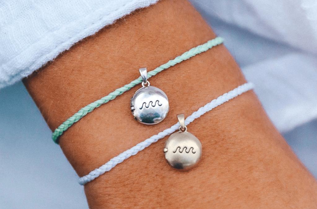 person wearing two bracelets