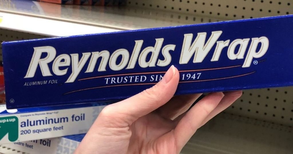 hand holding a box of Reynolds Wrap Aluminum Foil