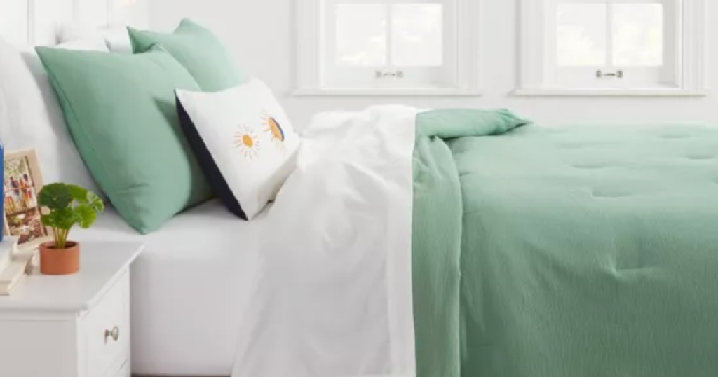 green comforter on bed