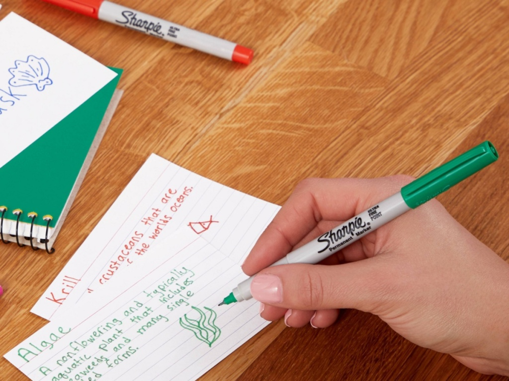hand writing on notecard with green permanent marker
