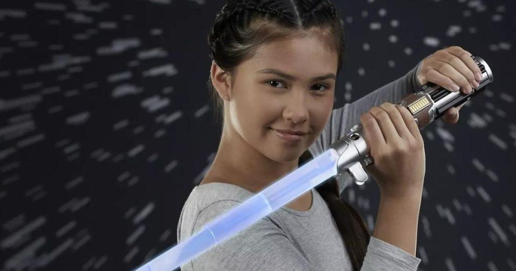 girl holding a lightsaber