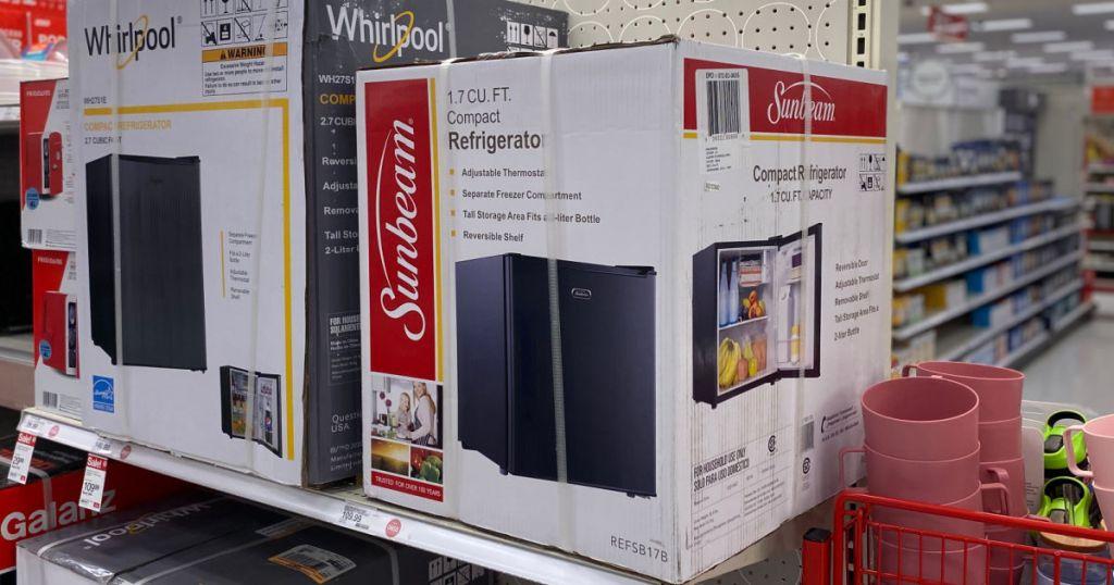two black mini refrigerators on shelf