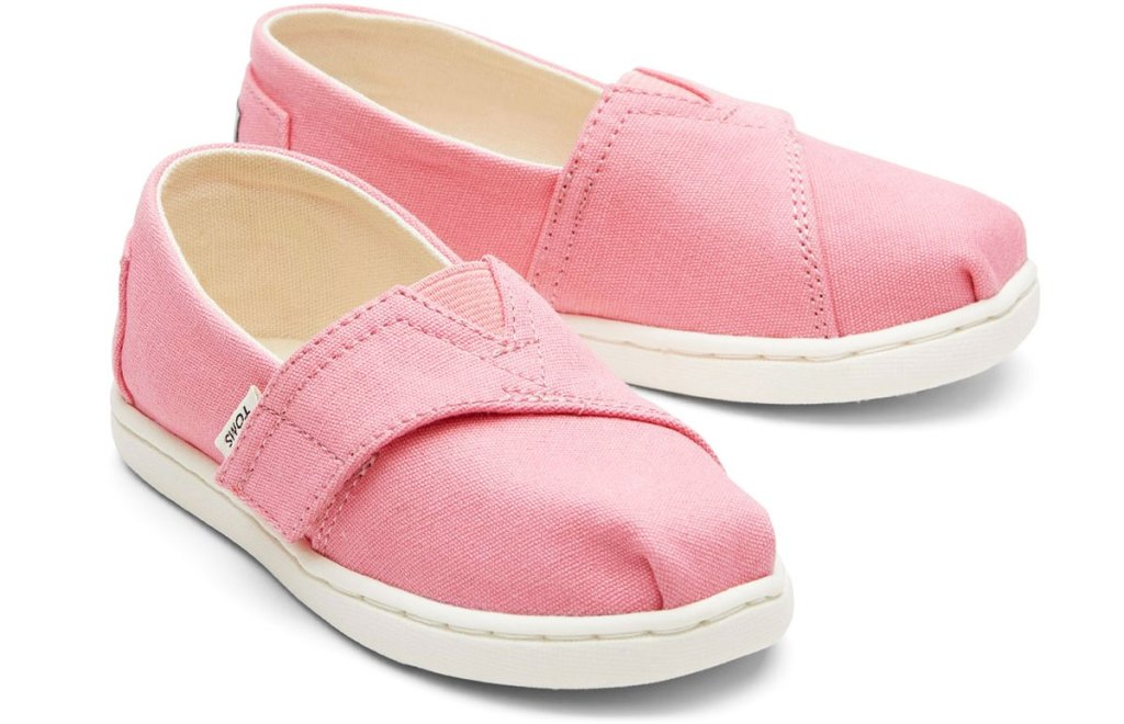 pair of pink toms shoes