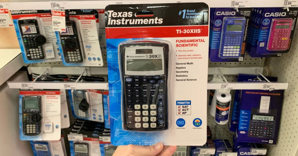 black graphing calculator in front of shelf