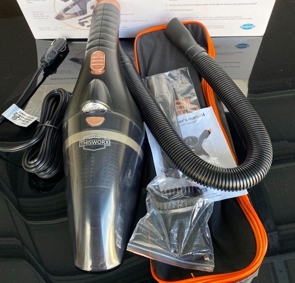 black handheld vacuum and attachments