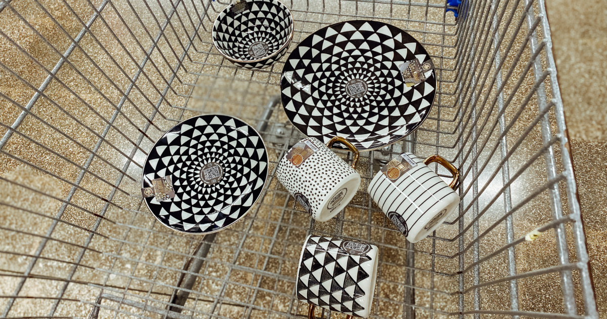 collection of black and white dinnerware pieces in a store shopping cart