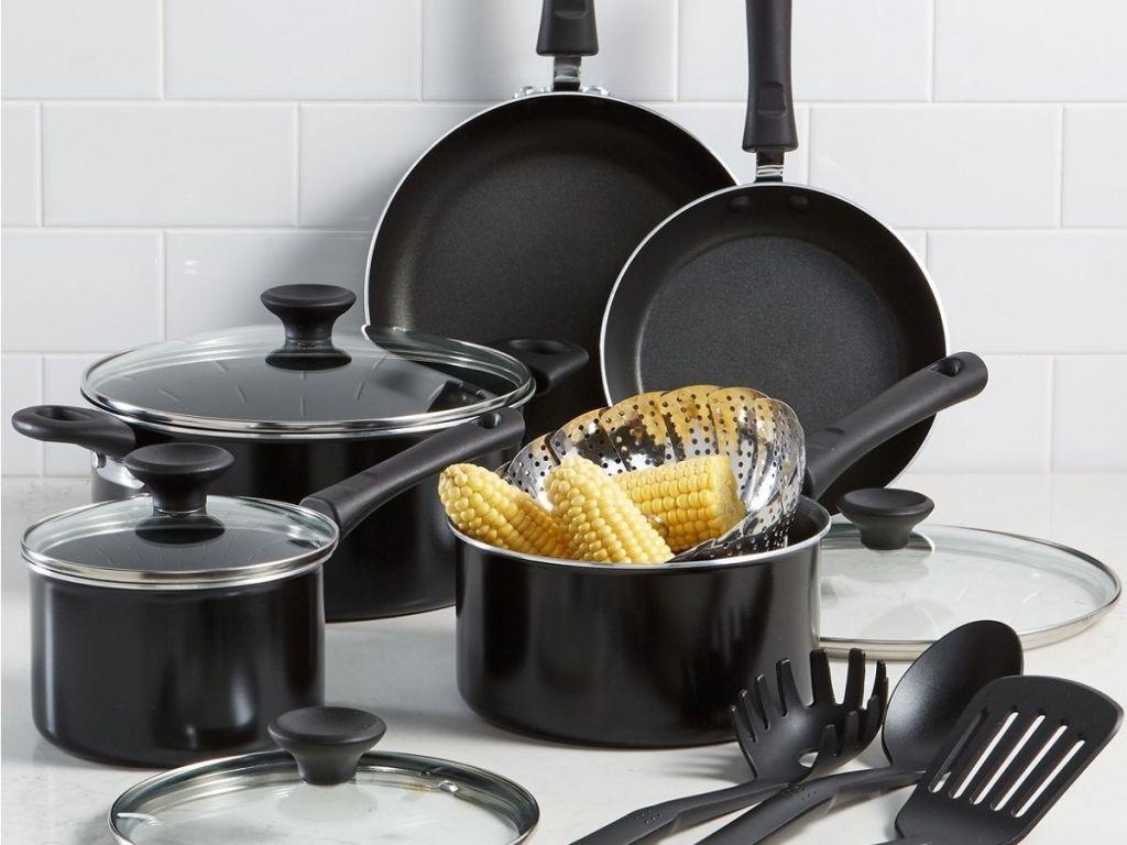 black pots pans and utensils